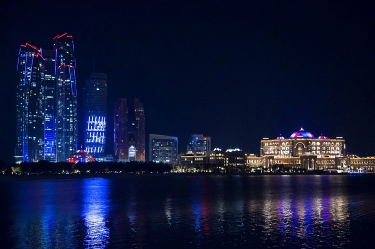 {Etihad Towers and Emirates Palace lit up in a sign of support for the people of France}